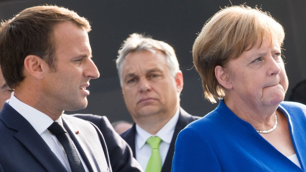France's President Emmanuel Macron, Hungary Prime Minister Viktor Orban, and Chancellor of Germany Angela Merkel arrive for a working dinner at The Parc du Cinquantenaire - Jubelpark Park in Brussels on July 11, 2018, during the North Atlantic Treaty Organization (NATO) summit. / AFP PHOTO / POOL / BENOIT DOPPAGNE
