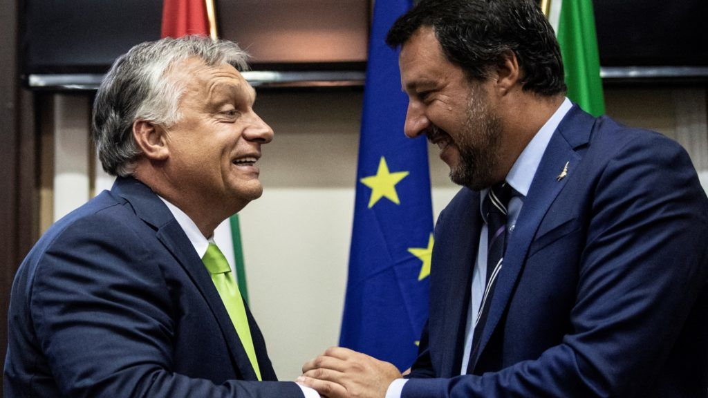 Italy's Interior Minister Matteo Salvini (R) shakes hands with Hungary's Prime Minister Viktor Orban at a press conference following a meeting in Milan on August 28, 2018. / AFP PHOTO / MARCO BERTORELLO