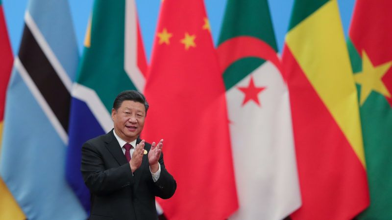 China's President Xi Jinping applauding as he attends the Forum On China-Africa Cooperation - Round Table Conference at the Great Hall of the People in Beijing on September 4, 2018. / AFP PHOTO / POOL / Lintao Zhang