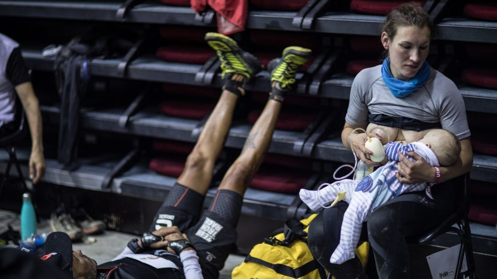 """Great-Britain's trail runner Sophie Power breastfeeds her three months old baby Cormac during a break as she competes in the 170 km Mount Blanc Ultra Trail (UTMB) race on August 31, 2018 in Courmayeur. The 16 th Ultra-Trail du Mont-Blanc (UTMB), a mountain ultramarathon with numerous passages in high altitude (>2500m) and in difficult weather conditions (night, wind, cold, rain or snow), takes place once a year around the Mont-Blanc across French, Italian and Switzerland's Alps. / AFP PHOTO / Mons Prod pour Strava / Alexis BERG / RESTRICTED TO EDITORIAL USE - MANDATORY CREDIT """"AFP PHOTO / Mons Prod pour Strava / Alexis BERG"""" - NO MARKETING NO ADVERTISING CAMPAIGNS - DISTRIBUTED AS A SERVICE TO CLIENTS ---"""