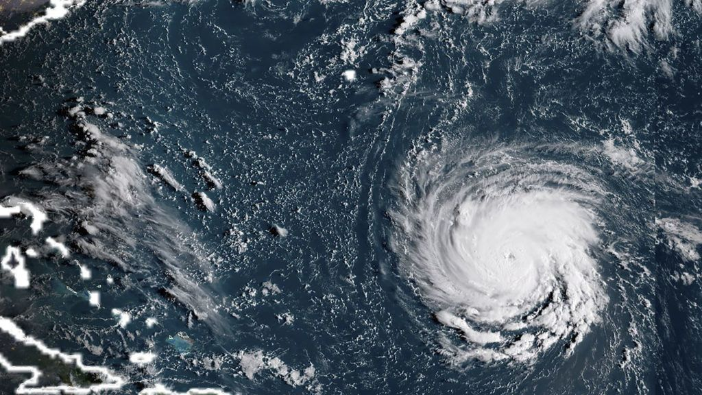 """This NOAA/RAMMB satellite image taken at 12:15:31 UTC on September 10, 2018, shows Hurricane Florence off the US east coast in the Atantic Ocean.  Hurricane Florence threatening the southeastern coast of the United States strengthened Monday morning into a Category 3 """"major"""" hurricane, the National Hurricane Center said. The NHC said the Atlantic hurricane's maximum sustained winds have increased to nearly 115 miles per hour (185 kilometers per hour) with higher gusts.""""Florence is expected to be an extremely dangerous major hurricane through Thursday,"""" it said.  / AFP PHOTO / NOAA/RAMMB / Lizabeth MENZIES / RESTRICTED TO EDITORIAL USE - MANDATORY CREDIT """"AFP PHOTO / NOAA/RAMMB"""" - NO MARKETING NO ADVERTISING CAMPAIGNS - DISTRIBUTED AS A SERVICE TO CLIENTS"""