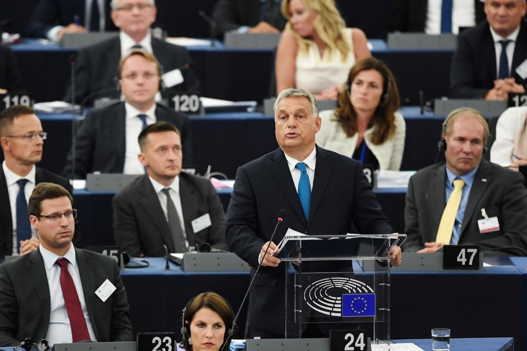 """Hungary's Prime Minister Viktor Orban delivers a speech during a debate concerning Hungary's situation as part of a plenary session at the European Parliament on September 11, 2018 in Strasbourg, eastern France. Hungarian Prime Minister Viktor Orban vowed, pn September 11, 2018, to defy EU pressure to soften his hardline anti-migrant stance, condemning what he called the """"blackmail"""" of his country. / AFP PHOTO / FREDERICK FLORIN"""