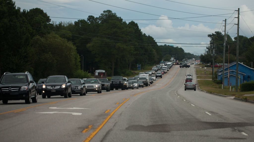 Vehicles line up along State Route 17 as people evacuate the coast of North Carolina on September 11, 2018 in Hampstead, North Carolina before the arrival of Hurricane Florence.  More than a million people were under evacuation orders in the eastern United States Tuesday, where powerful Hurricane Florence threatened catastrophic damage to a region popular with vacationers and home to crucial government institutions. / AFP PHOTO / Logan Cyrus