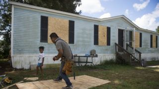 """Eduardo Corta cuts plywood boards to put on his mobile home a day before the arrival of Hurricane Florence in Wilmington, North Carolina on September 12, 2018. People fleeing North and South Carolina clogged coastal highways early Wednesday as Hurricane Florence, a monster Category 4 storm, bore down on the US east coast for a direct hit in a low-lying region dense with beachfront vacation homes.President Donald Trump, warning residents to get out of the way, said the federal government was """"ready for the big one that is coming.""""  / AFP PHOTO / ANDREW CABALLERO-REYNOLDS"""