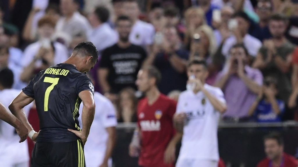 Juventus' Portuguese forward Cristiano Ronaldo reacts after receiving a red card during the UEFA Champions League group H football match between Valencia CF and Juventus FC at the Mestalla stadium in Valencia on September 19, 2018. / AFP PHOTO / JAVIER SORIANO