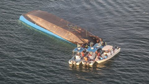 An aerial image shows the capsized ferry MV Nyerere which killed 131 people in Lake Victoria, Tanzania, on September 21, 2018.  Tanzanian President John Magufuli on September 21 ordered the arrest of the management of a ferry that capsized in Lake Victoria, as the death toll climbed to 131 and rescue workers pressed on with the search to find scores more people feared drowned. / AFP PHOTO / Stringer