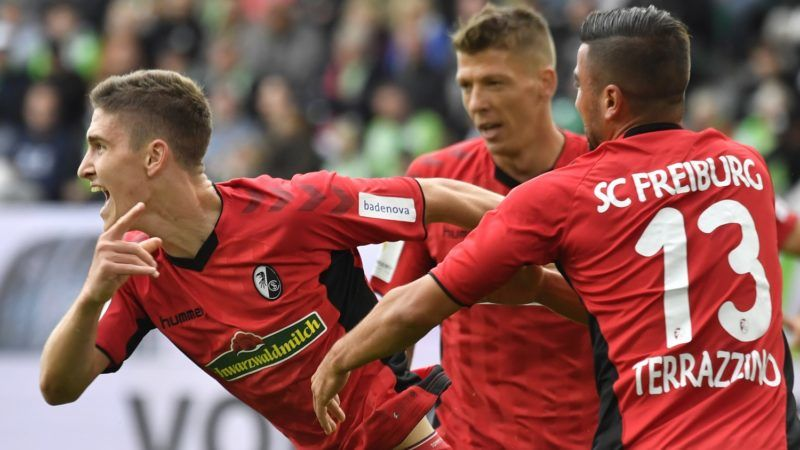 Freiburg's Hungarian midfielder Roland Sallai celebrates after scoring during the German First division Bundesliga football match between VfL Wolfsburg and SC Freiburg in Wolfsburg, on September 22, 2018. / AFP PHOTO / John MACDOUGALL / DFL REGULATIONS PROHIBIT ANY USE OF PHOTOGRAPHS AS IMAGE SEQUENCES AND/OR QUASI-VIDEO