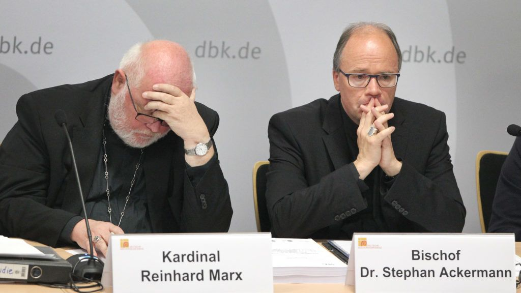 """Archbishop of Munich and Chairman of the German Bishops' Conference and Trier Bishop, Cardinal Reinhard Marx (L) and commissioner for sexual abuse issues in the ecclesiastical sphere, Stephan Ackermann give a press conference to present the results of the study on """"Sexual Abuse of Minors by Catholic Priests, Deacons and Male Religious"""" (MHG study) on September 25, 2018 in Fulda, western Germany.    Germany's Catholic Church is due on September 25, 2018 to confess and apologise for thousands of cases of sexual abuse against children, part of a global scandal heaping pressure on the Vatican. It will release the latest in a series of reports on sexual crimes and cover-ups spanning decades that has shaken the largest Christian Church, from Europe to the United States, South America and Australia.  / AFP PHOTO / Daniel ROLAND"""