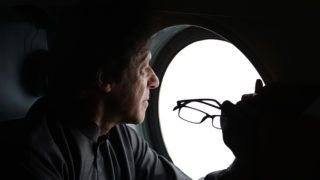 Pakistani opposition leader and PTI Chairman Imran Khan looks from a helicopter window as he looks at a tree plantation in Bannu district on March 15, 2017.   The project kicked off in June 2015, and so far 250 million saplings have been raised in largely private nurseries across Khyber Pakhtunkhwa (KP) province. / AFP PHOTO / FAROOQ NAEEM