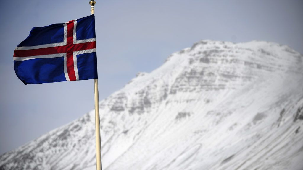TO GO WITH AFP STORY :ICELAND-VOLCANO-ERUPTION-KATLA-FOCUS An Icelandic flag flies over Vik, a village sitting at the base of the Myrdalsjokull glacier, which is part of the ice cap sealing the Katla volcano, in Vik, on April 22, 2010. Katla, a volcano 10 times more powerful than neighbour Eyjafjallajökull, which erupted last week and impacted air traffic worldwide, has erupted in intervals of 40-80 years and its last eruption was in 1918. The village of Vik sits between the two main lava and glacial flood routes and has set up evacuation plans to abandon the village promptly if Katla erupts. AFP PHOTO/Emmanuel Dunand / AFP PHOTO / EMMANUEL DUNAND
