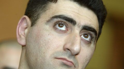 """Azerbaijani army officier Lieutenant Ramil Safarov(C) looks upwards as he listens to the verdict 13 April 2006, a conviction of  life imprisonment for hacking to death an Armenian lieutenant while attending a NATO-sponsored training course in Budapest. Judge Andras Vaskuti of the Budapest district court ruled that Ramil Safarov, now 29 and an Azerbaijani army lieutenant, killed Armenian Lieutenant Gurgen Markarian, 26, in """"premeditated, malicious and an unusually cruel"""" way by nearly decapitating him with axe while he slept. Safarov will be eligible for parole in 30 years, according to the ruling.     AFP PHOTO / ATTILA KISBENEDEK / AFP PHOTO / ATTILA KISBENEDEK"""