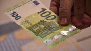 FRANKFURT, GERMANY - SEPTEMBER 17 : A person holds a sample of new 100 Euro banknote at ECB headquarters in Frankfurt, Germany on September 17, 2018. New security features would make new banknotes harder to counterfeit as they will be released to the market on March 28 in 2019.  Abdulselam Durdak / Anadolu Agency