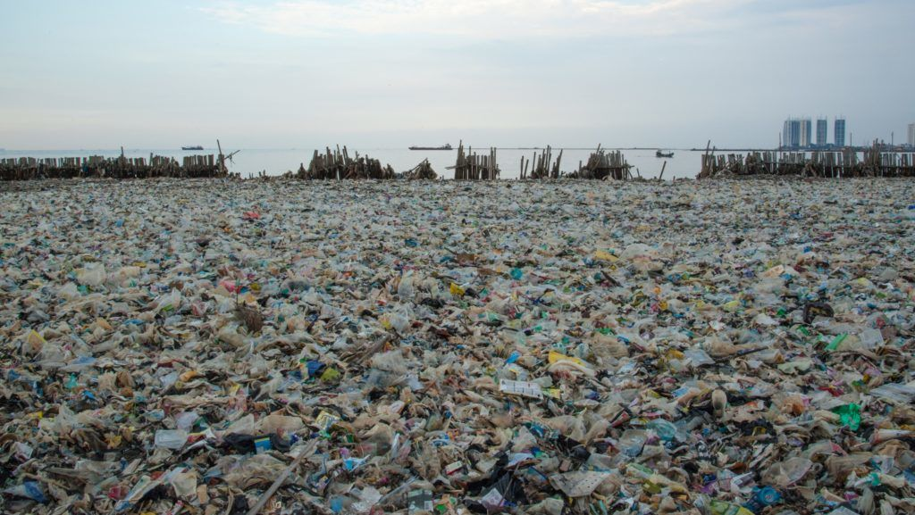 JAKARTA, INDONESIA - MARCH 17: A pile of garbage contact with the open sea at fishermen village Muara Kamal in Jakarta, Indonesia on March 17, 2018. Indonesia has 21% of the Asia-Pacific's total water supply, only 70% of the total population has access to clean water and sanitation. Anton Raharjo / Anadolu Agency