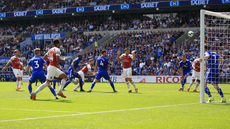 CARDIFF, WALES - SEPTEMBER 02: Shkodran Mustafi of Arsenal scores the opening goal during the Premier League match between Cardiff City and Arsenal FC at Cardiff City Stadium on September 2, 2018 in Cardiff, United Kingdom. (Photo by Marc Atkins/Getty Images)