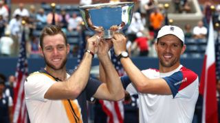 NEW YORK, NY - SEPTEMBER 07:  Jack Sock and Mike Bryan of The United States celebrate victory with the winners trophy following the men's doubles final against Lukasz Kubot of Poland and Marcelo Melo of Brazil on Day Twelve of the 2018 US Open at the USTA Billie Jean King National Tennis Center on September 7, 2018 in the Flushing neighborhood of the Queens borough of New York City.  (Photo by Al Bello/Getty Images)