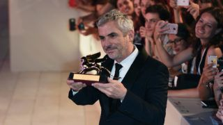 VENICE, ITALY - SEPTEMBER 08:  Alfonso Cuaron with the Golden Lion for Best Film Award for 'Roma' walks the red carpet ahead of the Award Ceremony during the 75th Venice Film Festival at Sala Grande on September 8, 2018 in Venice, Italy.  (Photo by Eamonn M. McCormack/Getty Images)