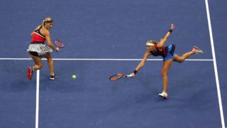 NEW YORK, NY - SEPTEMBER 09:  Timea Babos of Hungary and Kristina Mladenovic of France return the ball during the women's doubles final against Ashleigh Barty of Australia and Coco Vandeweghe of the United States on Day Fourteen of the 2018 US Open at the USTA Billie Jean King National Tennis Center on September 9, 2018 in the Flushing neighborhood of the Queens borough of New York City.  (Photo by Al Bello/Getty Images)