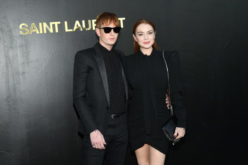 PARIS, FRANCE - SEPTEMBER 25:  Lindsay Lohan and a guest attend the Saint Laurent show as part of the Paris Fashion Week Womenswear Spring/Summer 2019 on September 25, 2018 in Paris, France.  (Photo by Stephane Cardinale - Corbis/Corbis via Getty Images)