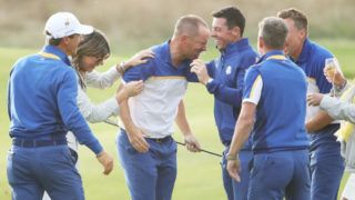 PARIS, FRANCE - SEPTEMBER 30:  Alex Noren of Europe celebrates with Team Europe after winning his match on the 18th green as Europe win The Ryder Cup during singles matches of the 2018 Ryder Cup at Le Golf National on September 30, 2018 in Paris, France.  (Photo by Christian Petersen/Getty Images)