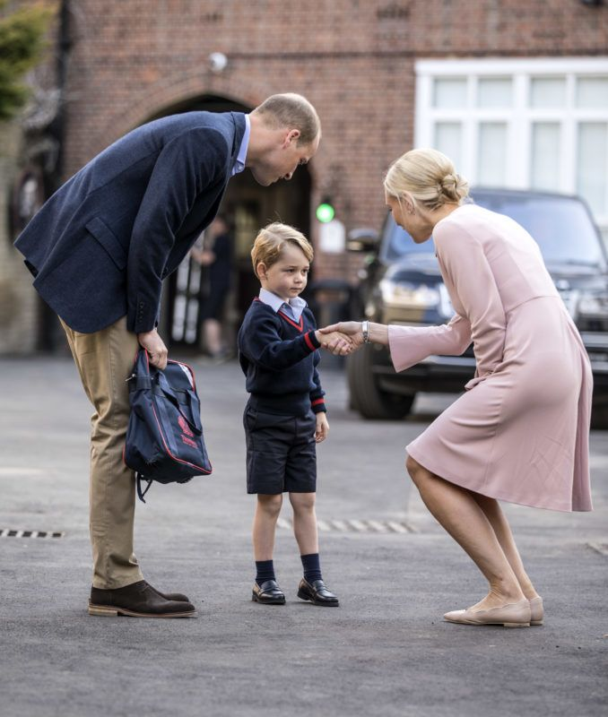 LONDON, ENGLAND - SEPTEMBER 7: Prince George of Cambridge arrives for his first day of school with his father Prince William, Duke of Cambridge as they are met Head of the lower school Helen Haslem at Thomas's Battersea on September 7, 2017 in London, England. (Photo by Richard Pohle - WPA Pool/Getty Images)