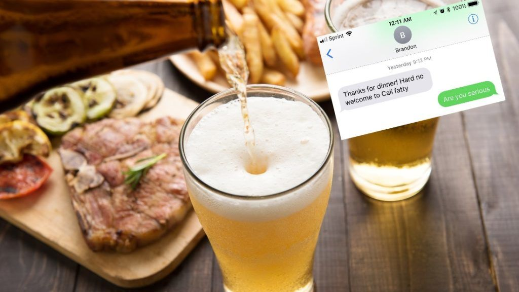 Beer being poured into glass with gourmet steak and french fries on wooden background.