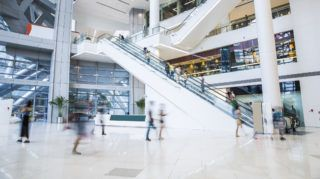 busy shopping mall, long exposure time, shoppers moving are deliberately blurred