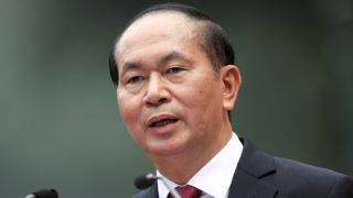 (FILES) In this file photo taken November 12, 2017, Vietnamese President Tran Dai Quang speaks during a press conference at the Presidential Palace in Hanoi. Vietnamese President Tran Dai Quang dies on September 21 at the age of 61 after a prologued illness, state run media reported.   / AFP PHOTO / POOL / LUONG THAI LINH