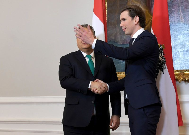 """Austrian Chancellor Sebastian Kurz (R) and Hungarian Prime Minister Viktor Orban address a press conference following a meeting at the Chancellery in Vienna on January 30, 2018.(Photo credit should read """"ROLAND SCHLAGER/APA-PictureDesk via AFP"""")"""