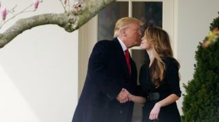 US President Donald Trump shakes hands with former communications director Hope Hicks shortly before making his way to board Marine One on the South Lawn and departing from the White House on March 29, 2018.  Trump is visiting Ohio to speak on infrastructure development before heading to Palm Beach, Florida.  / AFP PHOTO / Mandel NGAN