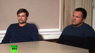 "A screengrab taken on September 13, 2018, from footage broadcast by Russia's state broadcaster Russia Today (RT), shows two men, purported to be Alexander Petrov and Ruslan Boshirov taking part in a television interview. Two men accused by London of poisoning former spy Sergei Skripal told Russian media on Thursday they visited the British city of Salisbury for tourist purposes and denied having anything to do with the murder attempt.  / AFP PHOTO / RUSSIA TODAY / HO / RESTRICTED TO EDITORIAL USE - MANDATORY CREDIT  "" AFP PHOTO / RUSSIA TODAY (RT)""  -  NO MARKETING NO ADVERTISING CAMPAIGNS   -   DISTRIBUTED AS A SERVICE TO CLIENTS - NO ARCHIVES - NO USE AFTER 30 DAYS FROM SEPTEMBER 30"