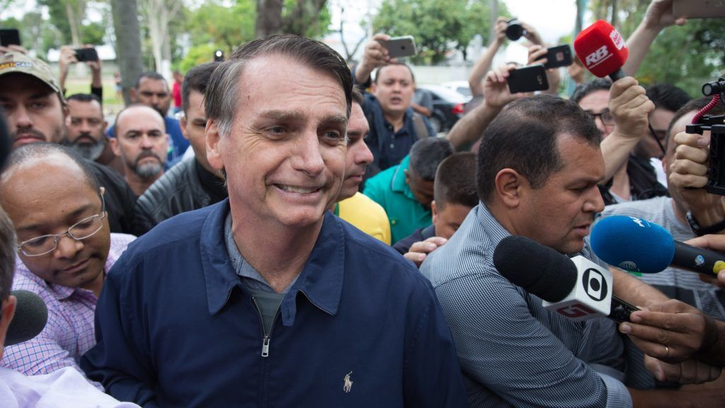 Brazil's right-wing presidential candidate for the Social Liberal Party (PSL) Jair Bolsonaro leaves Villa Militar, after casting his vote during general elections, in Rio de Janeiro, Brazil, on October 7, 2018. / AFP PHOTO / Fernando Souza