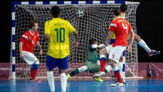 "This handout photo released by the Olympic Information Services (OIS) of the International Olympic Committee (IOC) shows Brazilian Guilherme Henrique Borges Sanches scores during the Gold Medal Match between Brazil and Russia in the Futsal Mens Tournament in the Futsal Main Stadium, Tecnopolis Park during the Youth Olympic Games, in Buenos Aires, Argentina,on October 18, 2018. (Photo by Ivo GONZALEZ / OIS/IOC / AFP) / RESTRICTED TO EDITORIAL USE - MANDATORY CREDIT ""AFP PHOTO / OIS/IOC - IVO GONZALEZ"" - NO MARKETING - NO ADVERTISING CAMPAIGNS - DISTRIBUTED AS A SERVICE TO CLIENTS"