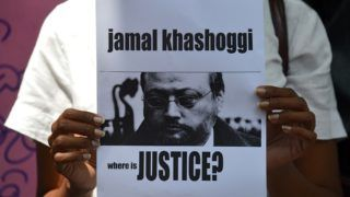 """A members of the Sri Lankan web journalist association holds a placard with the image of Saudi journalist Jamal Khashoggi during a demonstration outside the Saudi Embassy in Colombo on October 25, 2018, following Khashoggi's dissapearance on October 2 at the Saudi consulate in Istanbul. - Saudi Arabia's crown prince denounced the """"repulsive"""" murder of journalist Jamal Khashoggi and vowed justice will prevail, in his first public comments on the case, without addressing US accusations of a monumental cover-up. (Photo by LAKRUWAN WANNIARACHCHI / AFP)"""