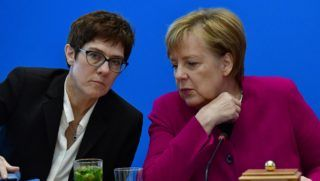 German Chancellor and leader of the Christian Democratic Union (CDU) Angela Merkel (R) talks with Secretary General of the Christian Democratic Union (CDU) Annegret Kramp-Karrenbauer prior a CDU leadership meeting at the CDU headquarters on October 29, 2018 in Berlin, a day after her fragile coalition suffered heavy losses in a key regional election. - German Chancellor Angela Merkel will not stand again as leader of her centre-right CDU, a party source told AFP, making way after 18 years for a successor following a series of regional vote defeats. (Photo by Tobias SCHWARZ / AFP)