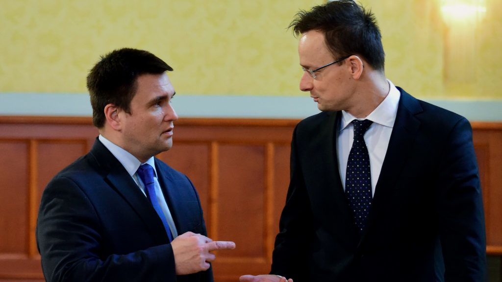 Ukrainian Foreign Minister Pavlo Klimkin (L) and Hungary's Minister of External Economy and Foreign Affairs Peter Szijjarto arrive at the conference hall of the ministry in Budapest on February 24, 2016 prior to their joint press conference. - Klimkin is on one-day official visit to Hungary. (Photo by ATTILA KISBENEDEK / AFP)