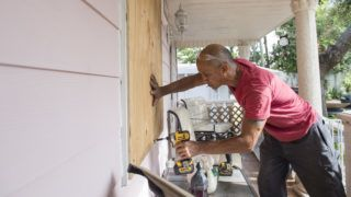 Pedro Marti covers the windows of his home with wood at the Sunnyside Trailer Park during preparations for Hurricane Irma in West Miami, Florida, September 8, 2017. Florida Governor Rick Scott warned that all of the state's 20 million inhabitants should be prepared to evacuate as Hurricane Irma bears down for a direct hit on the southern US state. / AFP PHOTO / SAUL LOEB