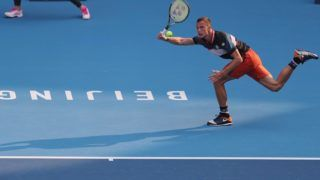 (181004) -- BEIJING, Oct. 4, 2018 (Xinhua) -- Marton Fucsovics of Hungary competes during the men's singles second round match against Marco Cecchinato of Italy at China Open tennis tournament in Beijing, China, Oct. 4, 2018. Marton Fucsovics won 2-0. (Xinhua/Luo Yuan)