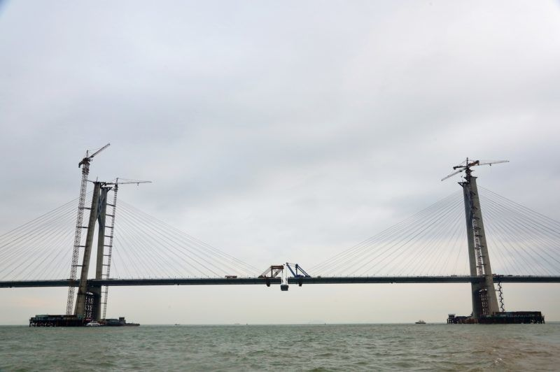 (181022) -- ZHUHAI, Oct. 22, 2018 (Xinhua) -- Photo taken on April 11, 2016 shows the construction site of the Hong Kong-Zhuhai-Macao Bridge in the Lingdingyang waters, south China. The Hong Kong-Zhuhai-Macao Bridge is to be officially open to traffic at 9 a.m. on Oct. 24.  The 55-kilometer-long bridge, situated in the Lingdingyang waters of the Pearl River Estuary, will be the world's longest sea bridge. The construction began on Dec. 15, 2009.     It will slash the travel time between Hong Kong and Zhuhai from three hours to just 30 minutes, further integrating the cities in the Pearl River Delta. (Xinhua/Wang Chaoying) (zyd)