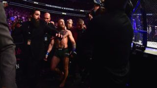 LAS VEGAS, NV - OCTOBER 06: Conor McGregor of Ireland is escorted out of the octagon after being defeated by Khabib Nurmagomedov of Russia in their UFC lightweight championship bout during the UFC 229 event inside T-Mobile Arena on October 6, 2018 in Las Vegas, Nevada.   Harry How/Getty Images/AFP