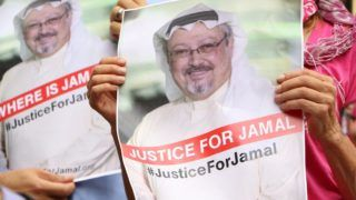 WASHINGTON, USA - OCTOBER 10: A member of the Organization 'Justice for Jamal Khashoggi' holds a picture of Khashoggi as she and other members hold news conference for disappearance of Saudi journalist in front of The Washington Post headquarters in Washington D.C. with the attendance of Congressman Gerry Connolly and figures from CAIR and Pen America spoke, in Washington D.C., United States on October 10, 2018. Umar Farooq / Anadolu Agency