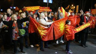 """SKOPJE, MACEDONIA - SEPTEMBER 30: Supporters of a """"boycott"""" for the name-change referendum celebrate the low voter participation on the referendum on the Macedonia's name change in front of the parliament building in Skopje,  Macedonia on September 30, 2018. According to Macedonian State Election Commission, only 34.09 percent of the 1.8 million voters participated in the referendum. Macedonian law requires a turnout of at least 50 percent plus one vote for the referendum to be valid.   Bekim Laci / Anadolu Agency"""