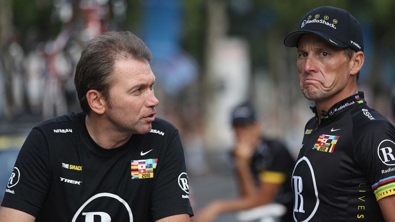 PARIS - JULY 25:  Johan Brunyeel (L) talks with Lance Armstrong of team Radioshack after the twentieth and final stage of Le Tour de France 2010, from Longjumeau to the Champs-Elysees in Paris on July 25, 2010 in Paris, France.  (Photo by Bryn Lennon/Getty Images)