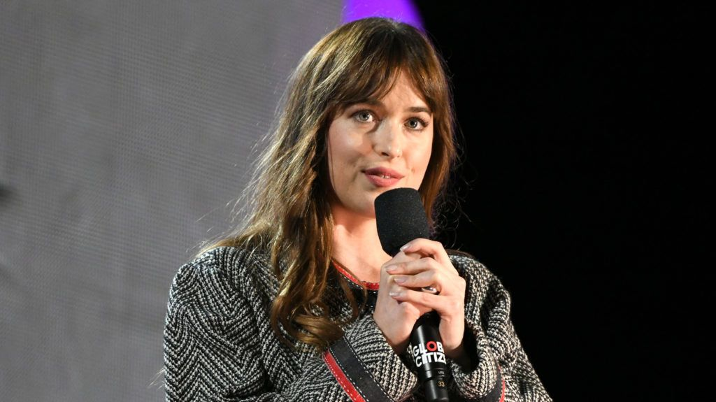 NEW YORK, NY - SEPTEMBER 29:  Actress Dakota Johnson speaks onstage during the 2018 Global Citizen Concert at Central Park, Great Lawn on September 29, 2018 in New York City.  (Photo by Michael Kovac/FilmMagic)