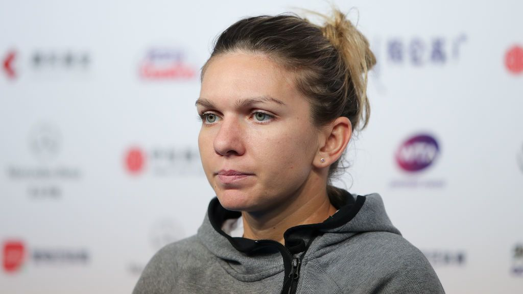 BEIJING, CHINA - SEPTEMBER 30:  Simona Halep of Romania reacts during a press conference after losing to Ons Jabeur of Tunisia in their Women's Singles 1nd Round match of the 2018 China Open at the China National Tennis Centre on September 30, 2018 in Beijing, China.  (Photo by Lintao Zhang/Getty Images)
