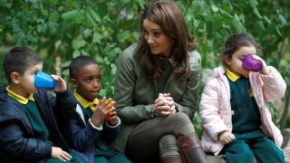 LONDON, ENGLAND - OCTOBER 02: Catherine, Duchess of Cambridge sits on a log with children during a visit to Sayers Croft Forest School and Wildlife Garden on October 2, 2018 in London, England.  Sayers Croft is an activity centre aimed at educating and involving children and the local community in the environment. (Photo by Peter Nicholls - WPA Pool/Getty Images)