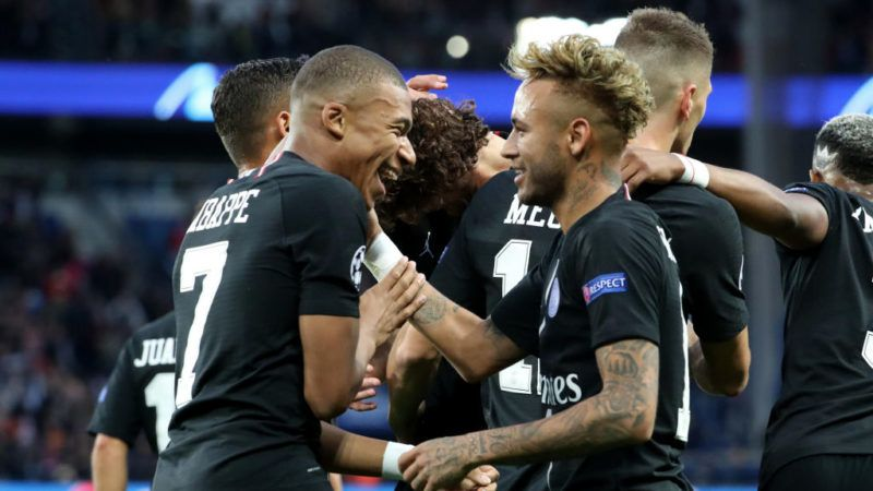 PARIS, FRANCE - OCTOBER 03:  Neymar Jr of Paris Saint-Germain celebrates his second goal with Kylian Mbappe during the Group C match of the UEFA Champions League between Paris Saint-Germain and Red Star Belgrade at Parc des Princes on October 3, 2018 in Paris, France.  (Photo by Xavier Laine/Getty Images)