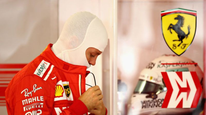 SUZUKA, JAPAN - OCTOBER 06: Sebastian Vettel of Germany and Ferrari prepares to drive in the garage during qualifying for the Formula One Grand Prix of Japan at Suzuka Circuit on October 6, 2018 in Suzuka.  (Photo by Mark Thompson/Getty Images)