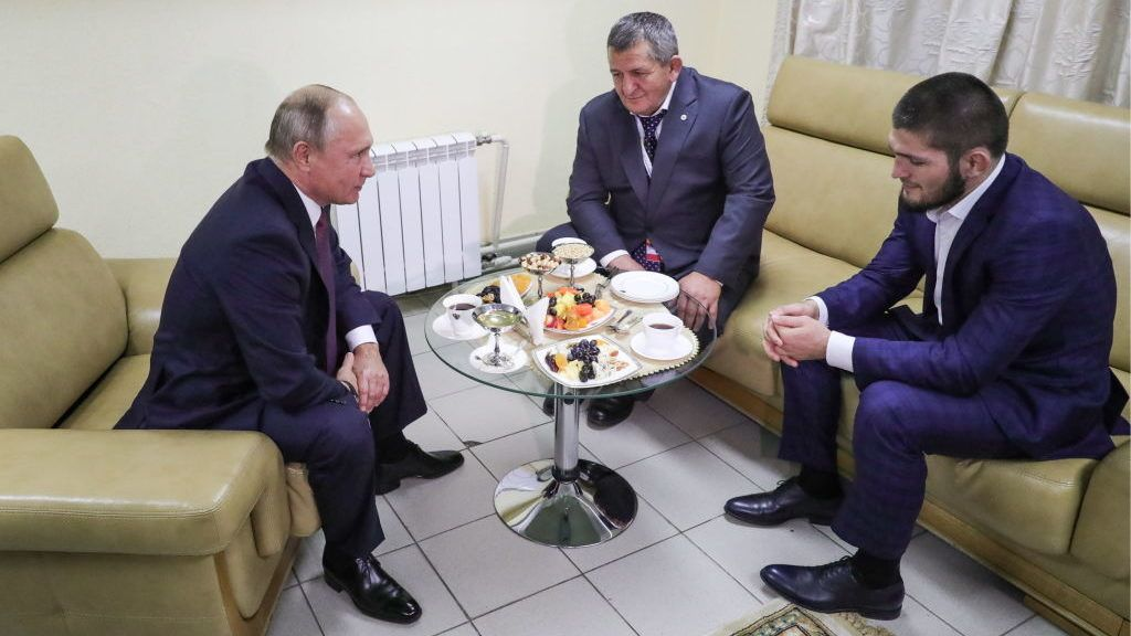ULYANOVSK, RUSSIA  OCTOBER 10, 2018: Russia's President Vladimir Putin, MMA fighter and UFC lightweight champion Khabib Nurmagomedov (L-R front), and his father and coach Abdulmanap Nurmagomedov during a meeting at the 7th Russia  A Sports Power international forum, at Volga-Sport-Arena. Mikhail Klimentyev/Russian Presidential Press and Information Office/TASS (Photo by Mikhail KlimentyevTASS via Getty Images)