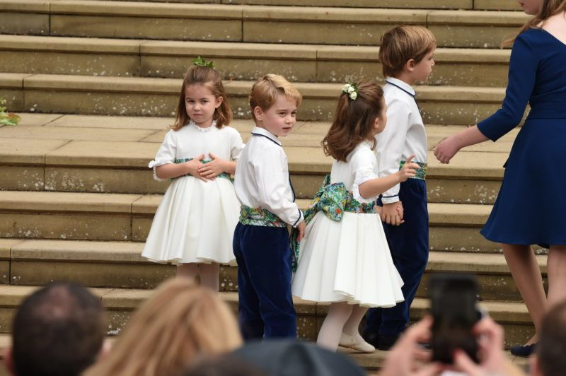 WINDSOR, ENGLAND - OCTOBER 12: The bridesmaids and page boys including Prince George of Cambridge and Princess Charlotte of Cambridge arrive with Lady Louise Mountbatten-Windsor, for the wedding of Princess Eugenie to Jack Brooksbank at St George's Chapel in Windsor Castle on October 12, 2018 in Windsor, England. (Photo by  Jeremy Selwyn - WPA Pool/Getty Images)