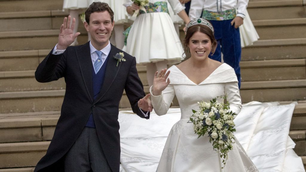 WINDSOR, ENGLAND - OCTOBER 12: Princess Eugenie and Jack Brooksbank leave St George's Chapel in Windsor Castle following their wedding on October 12, 2018 in Windsor, England. (Photo by Steve Parsons - WPA Pool/Getty Images)